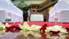 Rose petals on the floor of hall for wedding ceremony Stock Footage