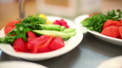 Plates with fresh vegetables driving on the trey at restaurant Stock Footage