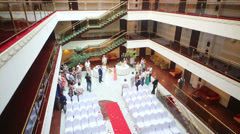 View from moving down lift to guests with bride and groom Stock Footage