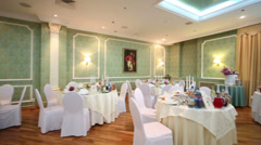 Hall with tables in restaurant decorated for wedding celebration Stock Footage