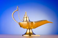 Ancient lamp against gradient background Stock Photos