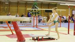 Girl does exercise at XIX International Gymnastics Tournament Stock Footage
