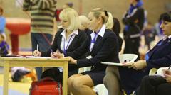 Judges take notes at XIX International Gymnastics Tournament Stock Footage