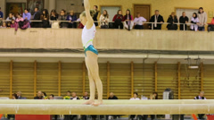 Girl exercises on log at XIX International Gymnastics Tournament - stock footage