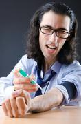 Stock Photo of Young druc addict with syringe