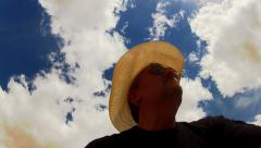 Man With Cowboy Hat Looks Heavenward To Partly Cloudy Sky Stock Footage