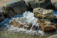 Bubbling water feature in the landscape Stock Photos