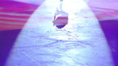 Colored shadow of girl figure skating at competition on stadium Stock Footage