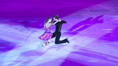 Pair figure skates at Young sportive display on ice skating shot Stock Footage