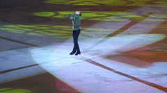 Man whirls at Young sportive display on ice skating shot Stock Footage