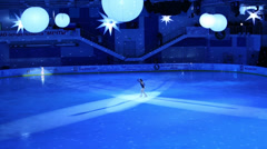 Girl figure skates with illumination at Young sportive display Stock Footage
