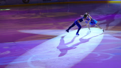 Young pair figure skate with illumination at Young sportive display - stock footage