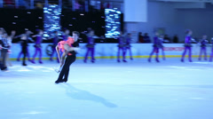 Pair and many girls in costumes figure skate Stock Footage