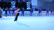 Stock Video Footage of Pair and many girls in costumes figure skate