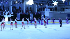 Girls in costumes figure skate at Young sportive display Stock Footage