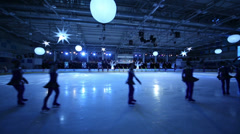 Figure skaters at Young sportives display on ice skating shot Stock Footage
