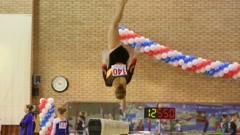 Girl jumps on boom in Hall Stadium at XIX Gymnastics Tournament Stock Footage