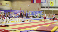 Girl jumps over vaulting horse in Hall Dynamo Stadium - stock footage