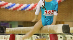 Legs of girl doing exercise on boom in Hall Dynamo Stadium Stock Footage