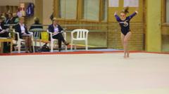 Girl somersaults at XIX International Gymnastics Tournament Stock Footage