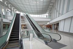 Escalator in the shopping mall Stock Photos