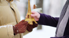Hands of seller with souvenir, drawings and man buying tower Stock Footage