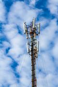 Telecommunications pole with blue sky Stock Photos