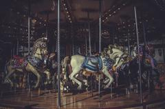 carousel, marry-go-round, image of the city of madrid, its characteristic arc - stock photo