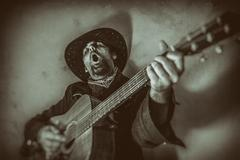 Singing Old West Cowboy With Guitar Stock Photos