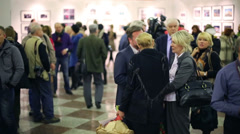People talk at exhibition Silver Camera 2012. Stock Footage