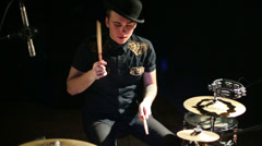 Young handsome drummer in hat plays in night club Stock Footage