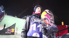 Stock Video Footage of Competitor with snowboard after contest BGV Grand Prix De Russie