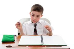 School student examining his work Stock Photos