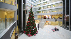 Hall with Christmas tree and moving lifts in office of Rosbank. Stock Footage