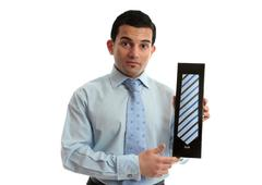 Salesman holding a tie Stock Photos