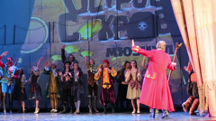 Actors and closing curtains at musical spectacle for children Stock Footage