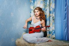 Girl and violin Stock Photos
