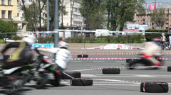 Motocross pursuit on asphalt for motorbikes Stock Footage