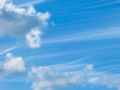 Blue sky and white fluffy clouds - stock photo