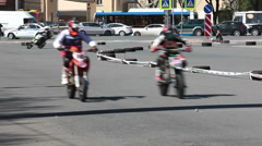 Motorbikers riding on motor track Stock Footage