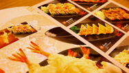 Stock Video Footage of Flipped menu at japanese restaurant. Macro video