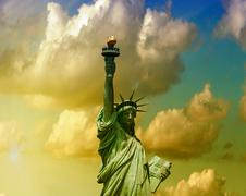 Colors of dusk behind Statue of Liberty - New York - stock photo