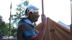 Roman soldier keeps guard, these clip was shot at a war reenactment Stock Footage