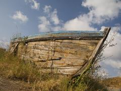 Stock Photo of Old nautical vessel - abandoned on the dry land