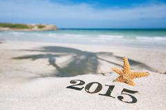 2015 letters with starfish, ocean , beach and seascape - stock photo