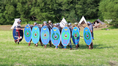 Small group of roman soldiers are attacking enemies at a roman war reenactment Stock Footage