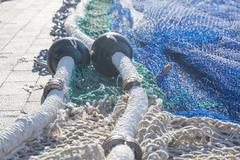 nets on pier. fishing boat arrived in port - stock photo