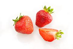 Beautiful strawberries isolated on white Stock Photos