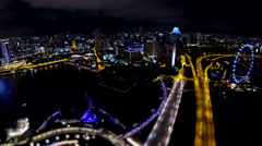 Overlooking time lapse night view of Marina Bay area in Singapore Stock Footage