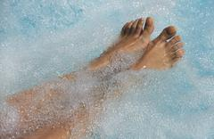 Women's feet in the jacuzzi to venous circulation Stock Photos